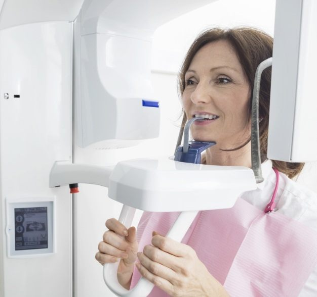 Woman receiving 3 D C T cone beam digital x-ray scan