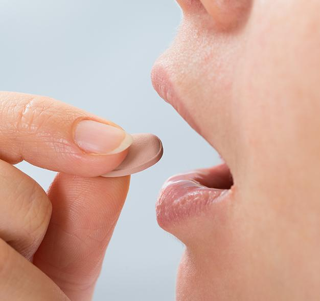 Patient taking oral conscious dental sedation pill