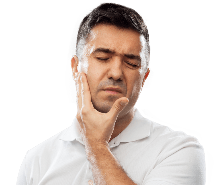 Man in need of TMJ therapy holding jaw in pain