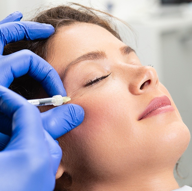 Woman receiving Botox treatment for TMJ pain