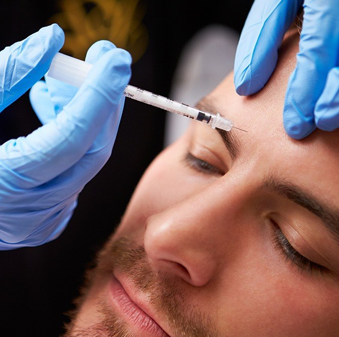 Man receiving Botox injections for TMJ therapy