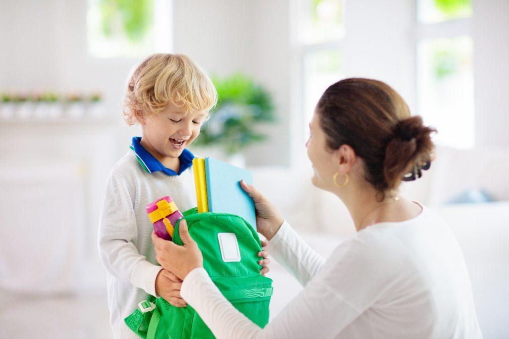 Mom helping child prepare for school